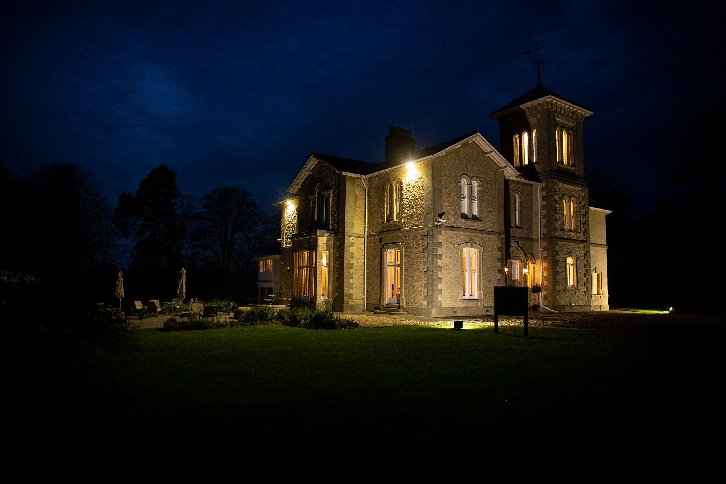 St. Tewdrics House lit up at night