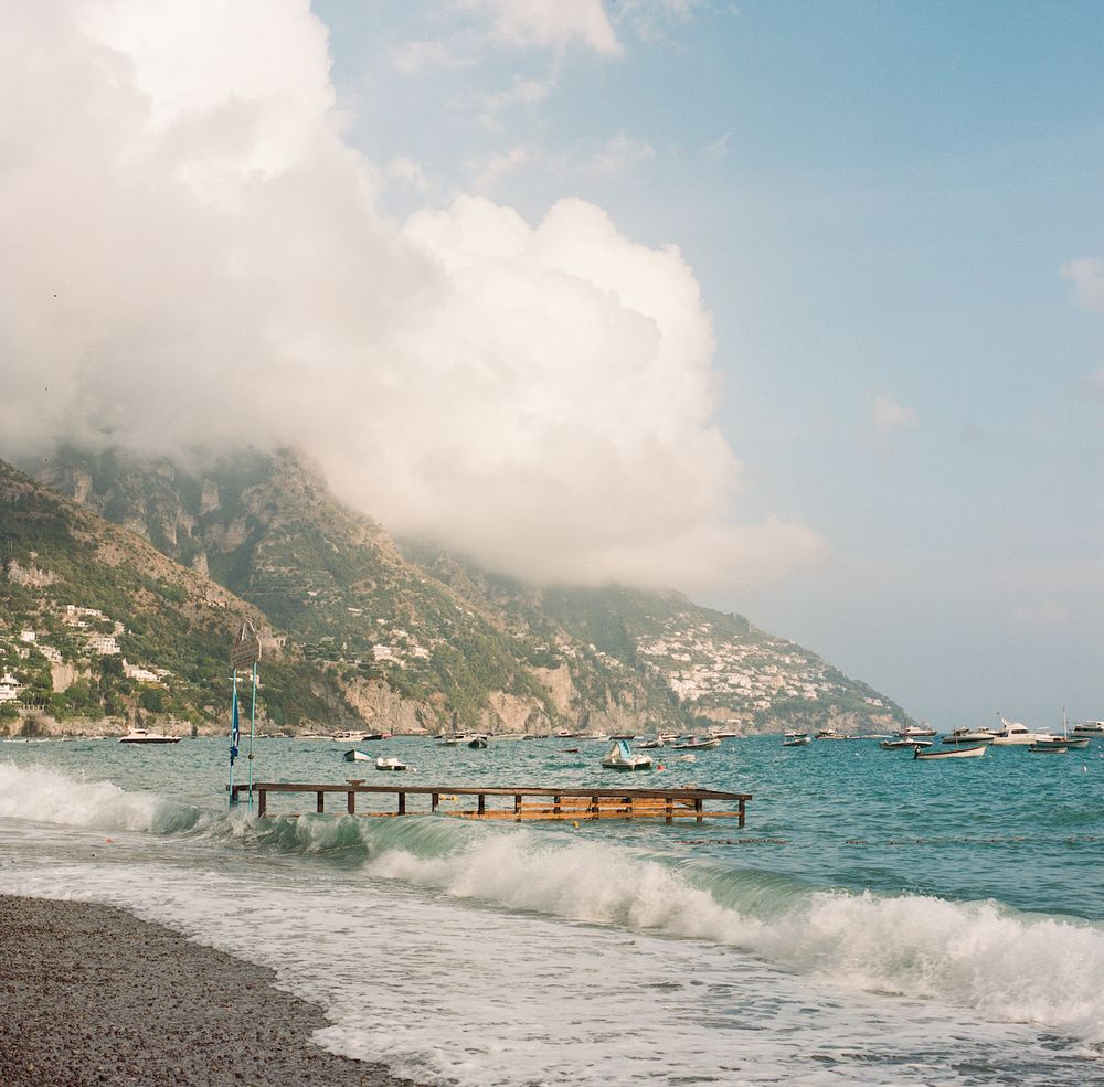 Aaron Snow Photography Italy Wedding Photographer Positano Beach Boats Waves Dock Clouds Ocean Hasselblad Camera