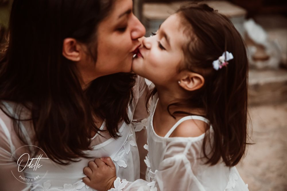 Little girl kissing her mother