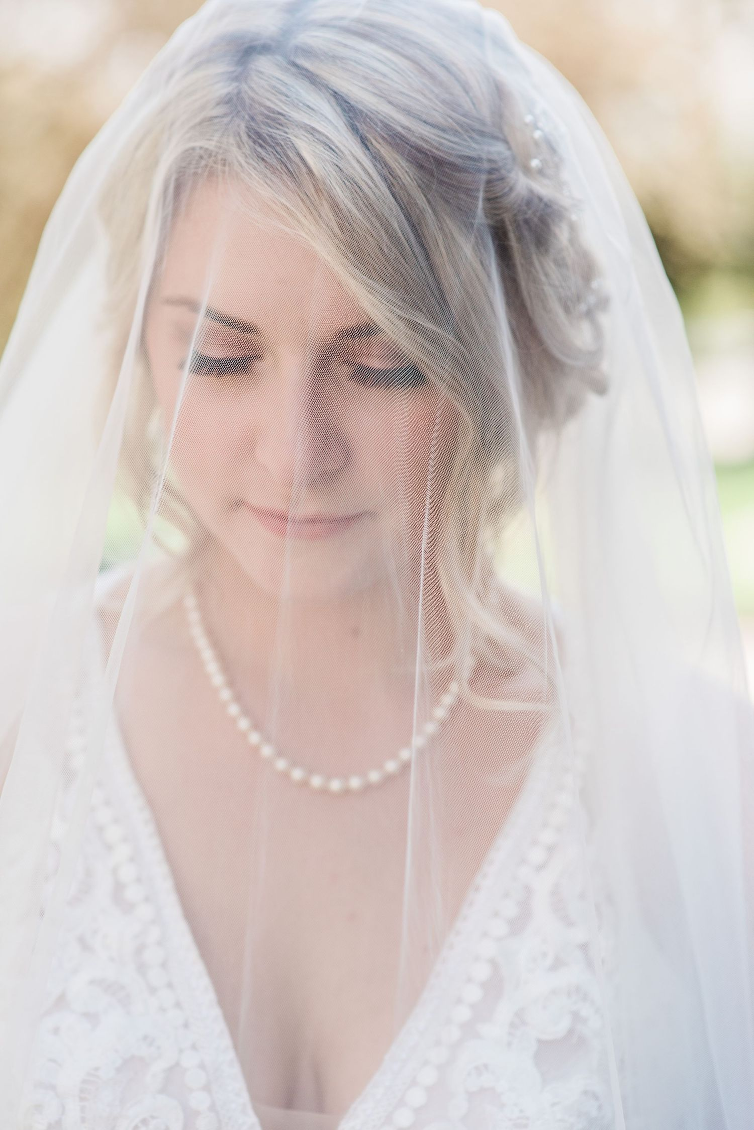 bride-under-veil-small-covid-wedding