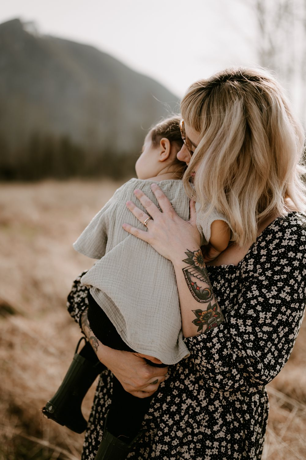 motherhood portrait by Tiffany Kelterer of mom holding and snuggling daughter in Snoqualmie WA