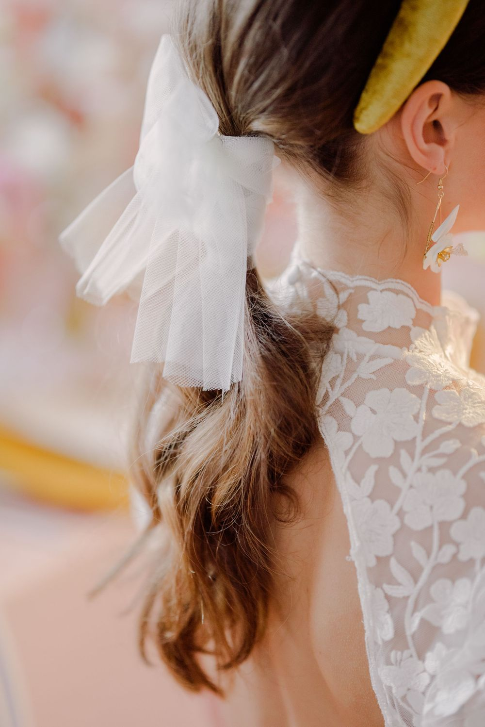 bridal hair style trend with loose curls and fashionable statement bow detail