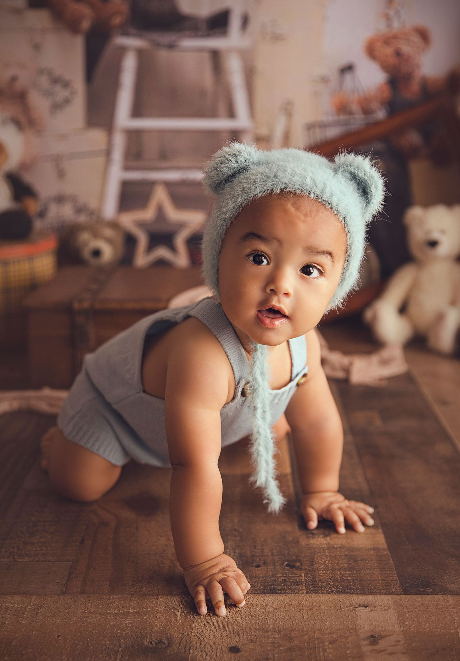 baby boy crawling dressed in blue