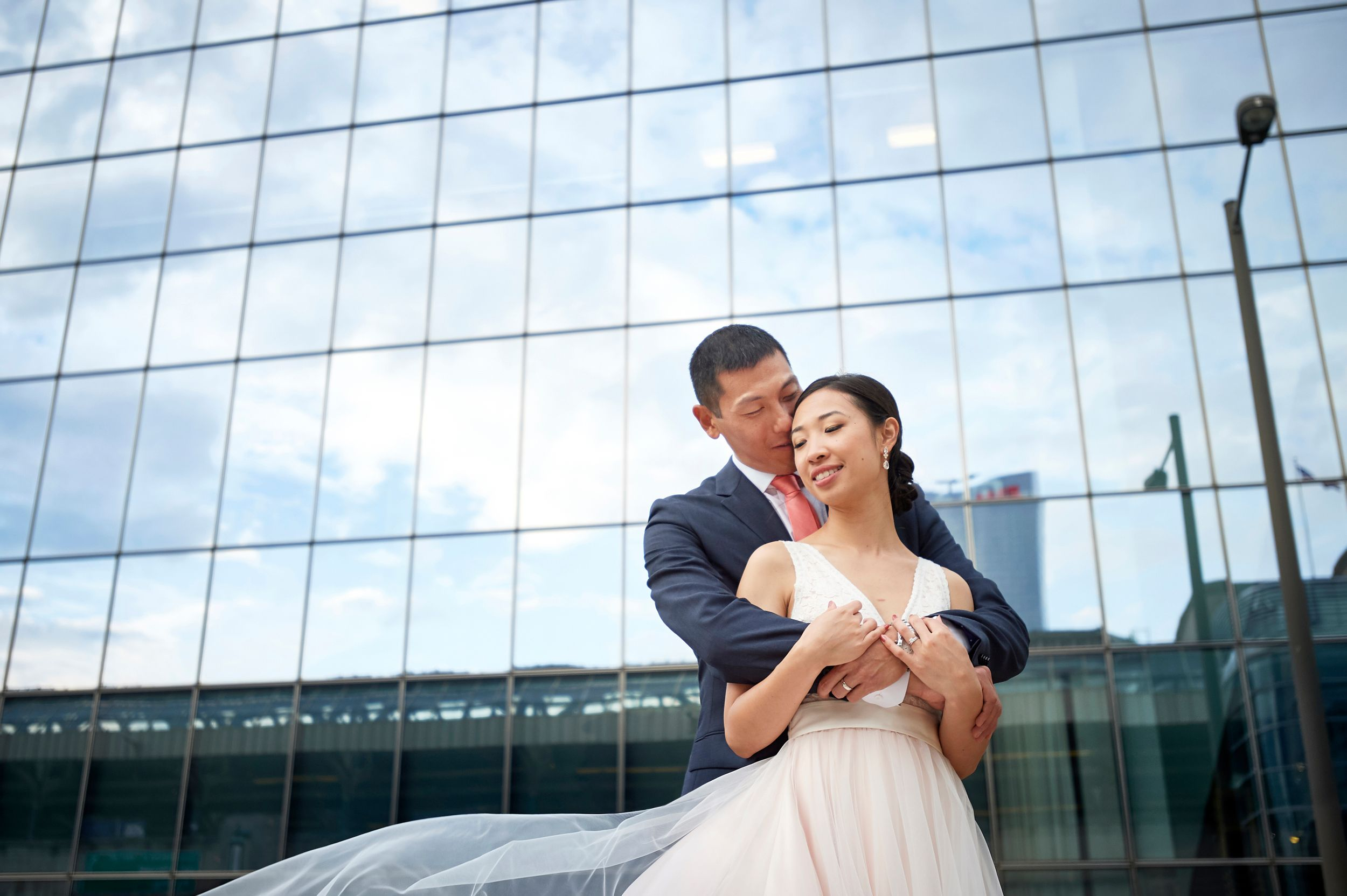 wedding photo of bride and groom outside JG domestic at Cira Center in philadelphia