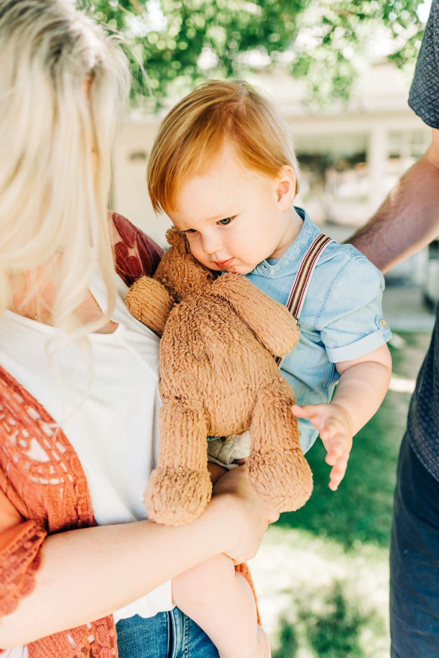 toddler with stuffed animal while at Phoenix, AZ family photo session