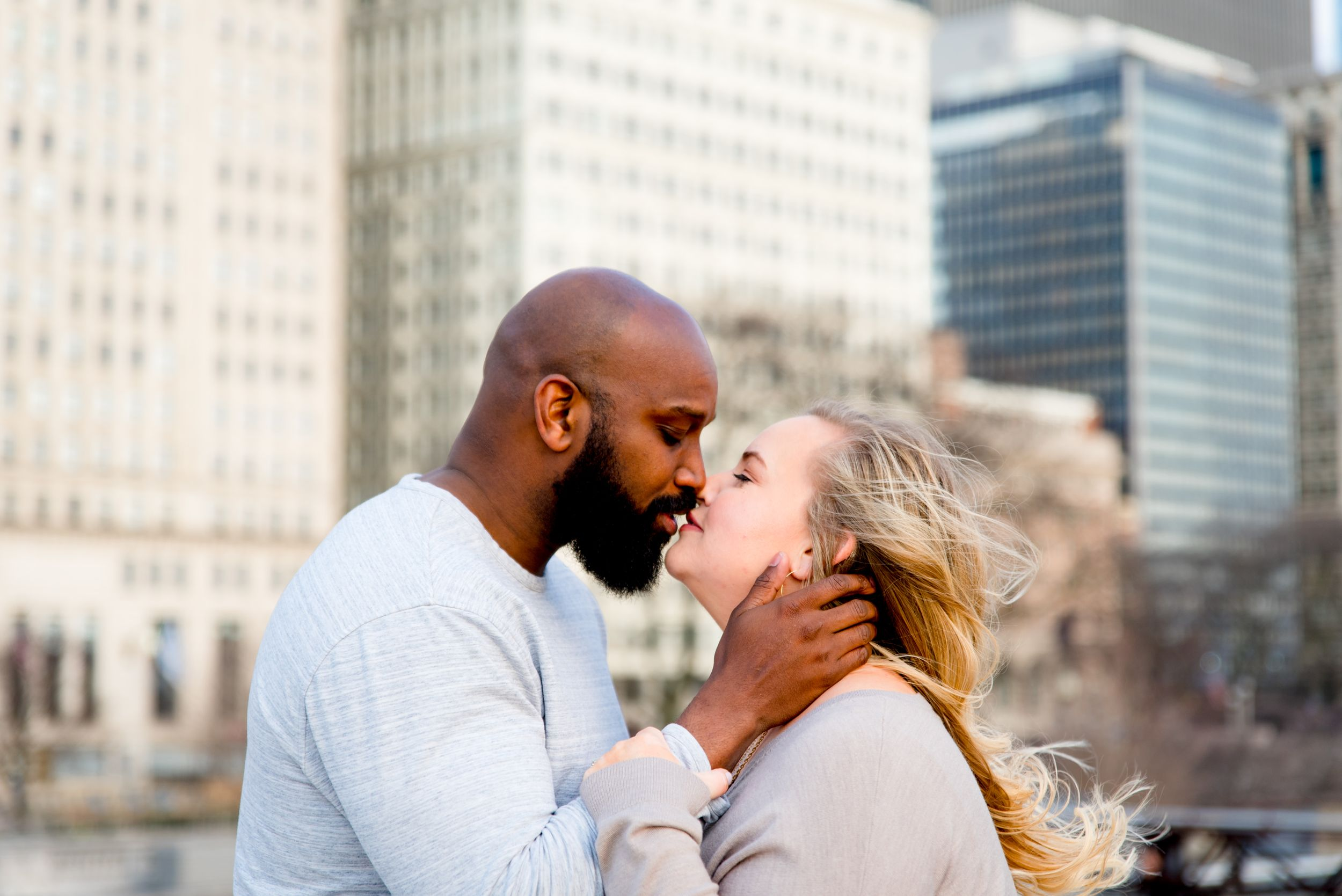 man and woman almost kissing in front of Michigan Ave for downtown Chicago sunrise engagement photos