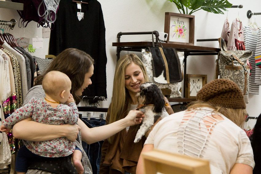Sip and Stamp party Liv & Rory both owners conversing with child and dog in arms