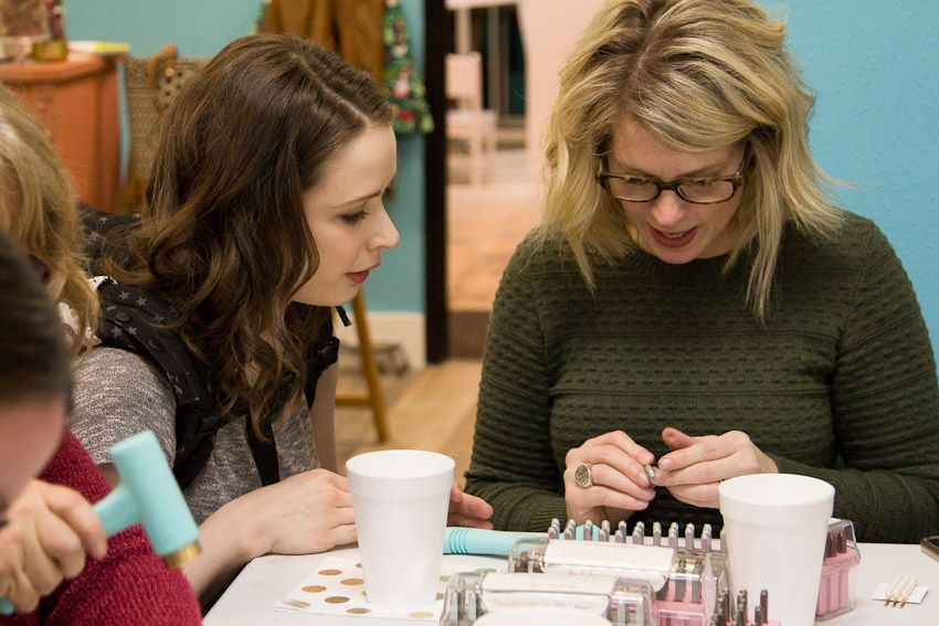 Sip and Stamp party Liv & Rory helping woman design her own custom jewelry