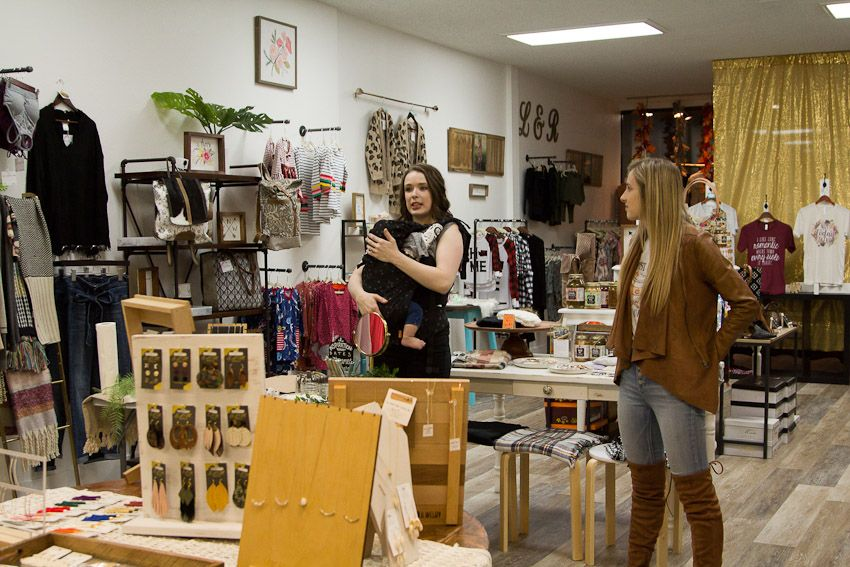 Sip and Stamp party Liv & Rory woman owners talking and explaining event in shop