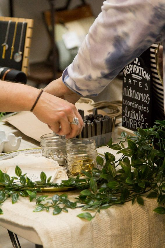 Sip and Stamp party Liv & Rory woman picking pieces to add to their personalized jewelry