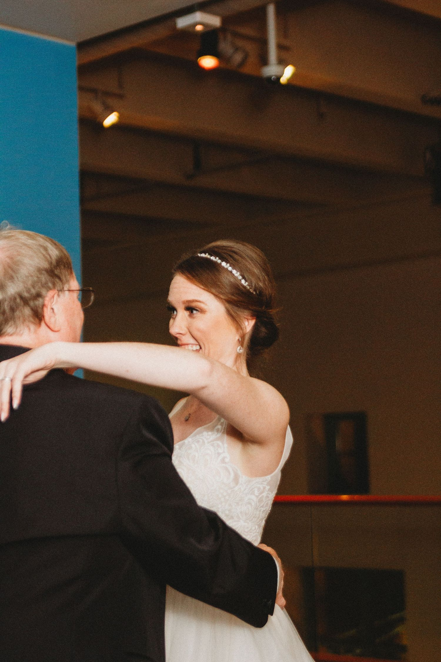 bride dancing with her father without the dinosaur head