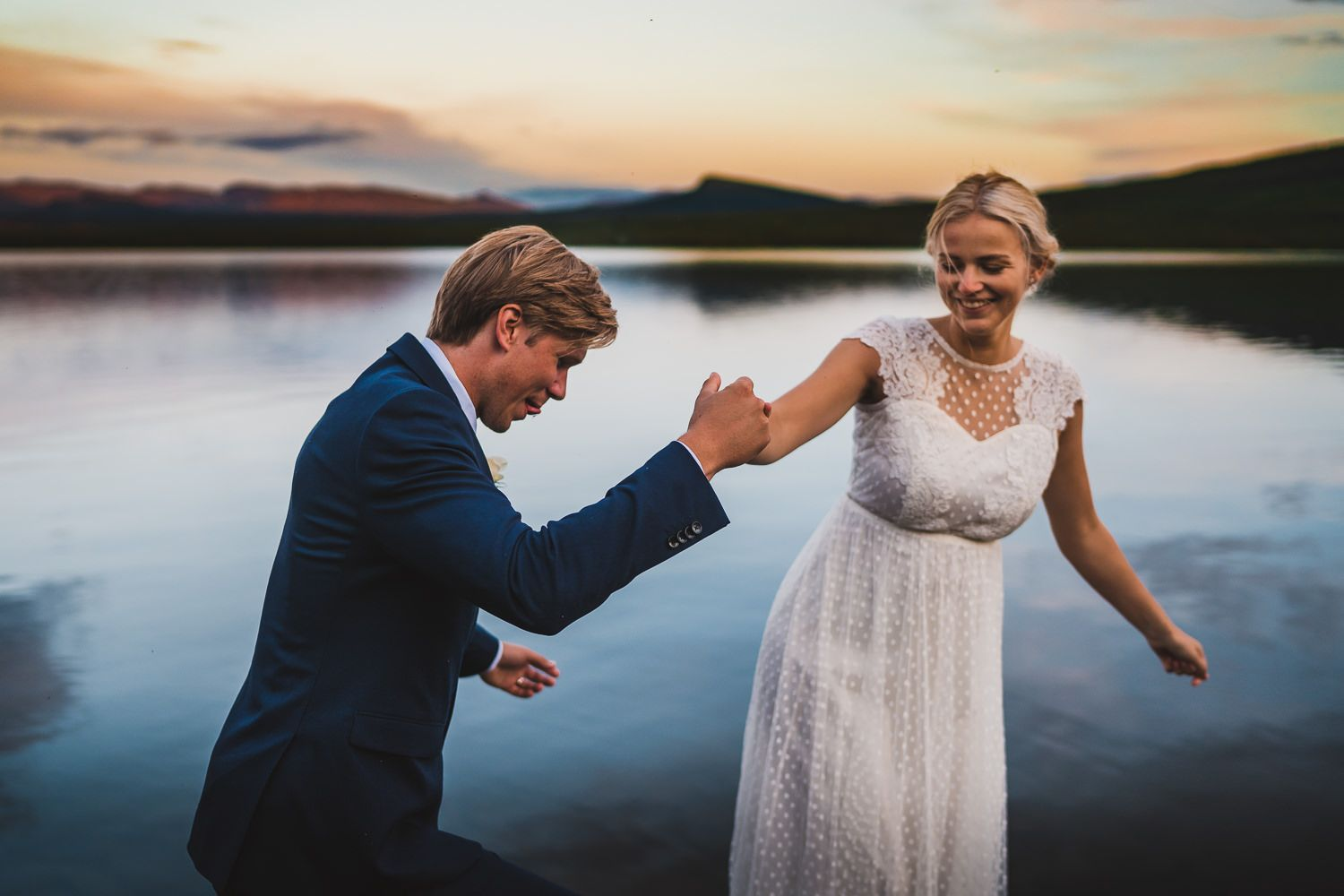 Photographer Maria Karlsson Swedish Adventure Elopement Couple and mountains in Norrland Bridal gown and flowers laughin