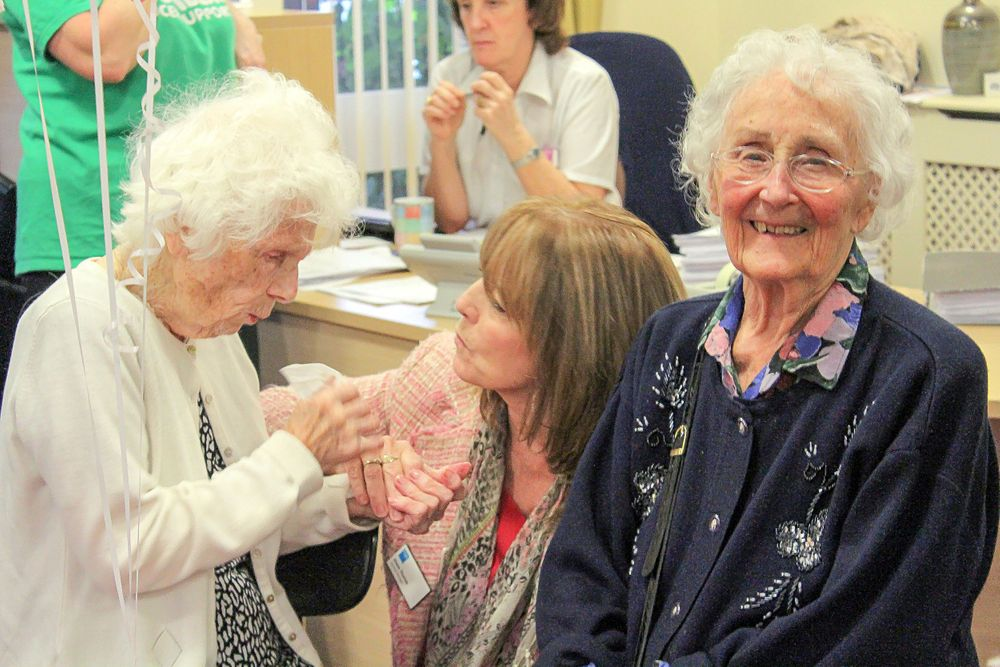 ladies chatting at the macmillan charity tea party