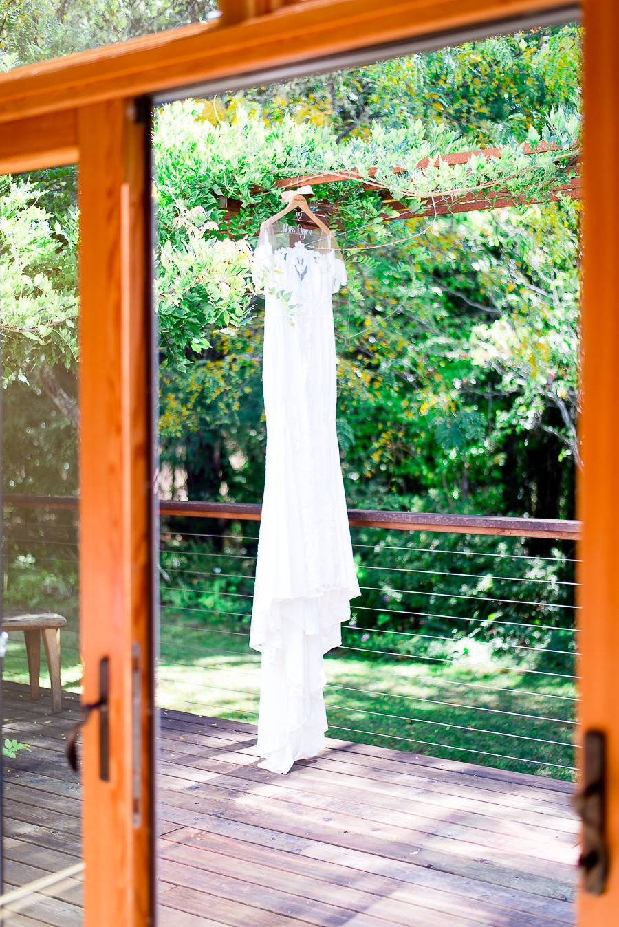 wedding dress hanging from pergola in Northern California patio