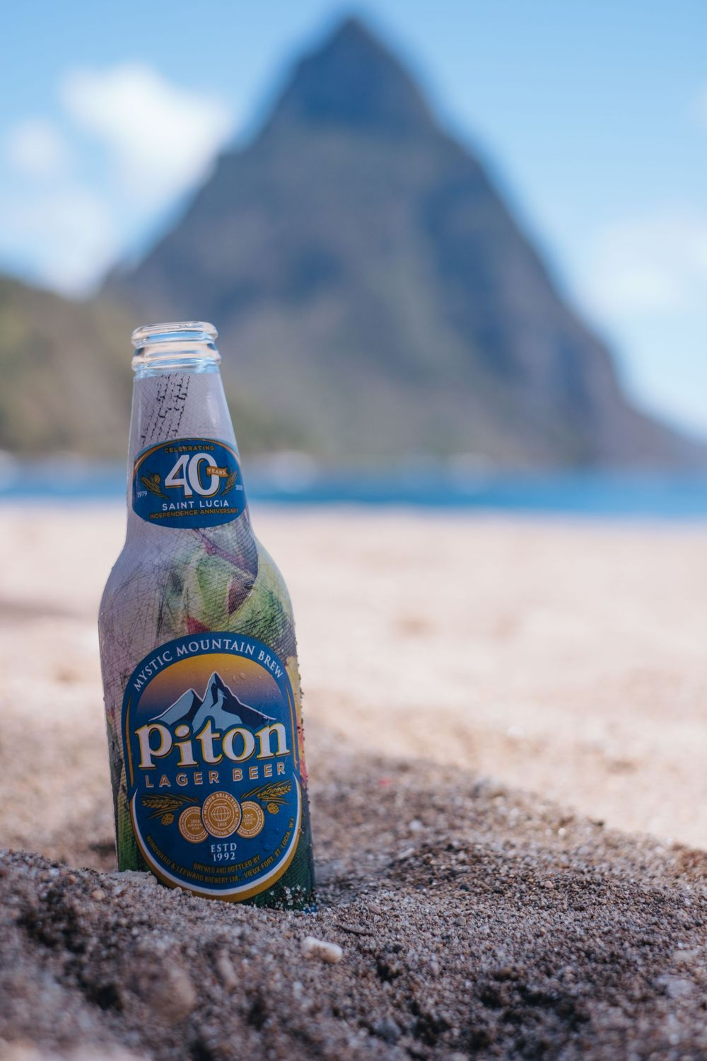 piton beer in the sand, piton in the background