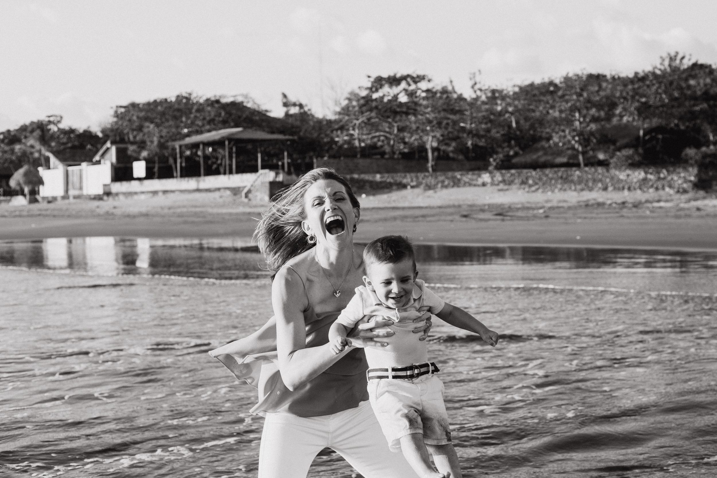 Mom and son play and laugh on a Nicaragua beach