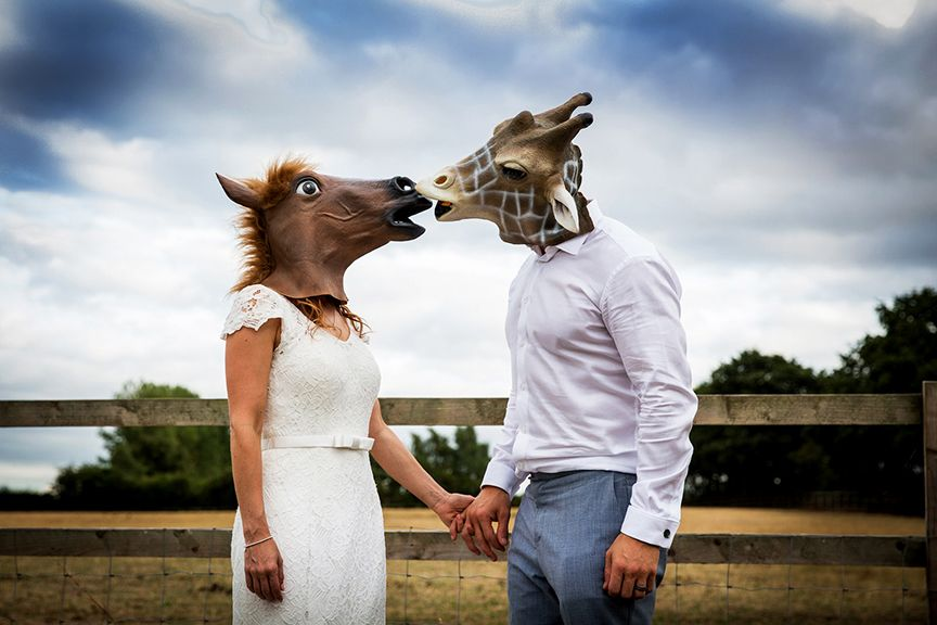 Bride & Groom wearing funny masks at Coton House Farm