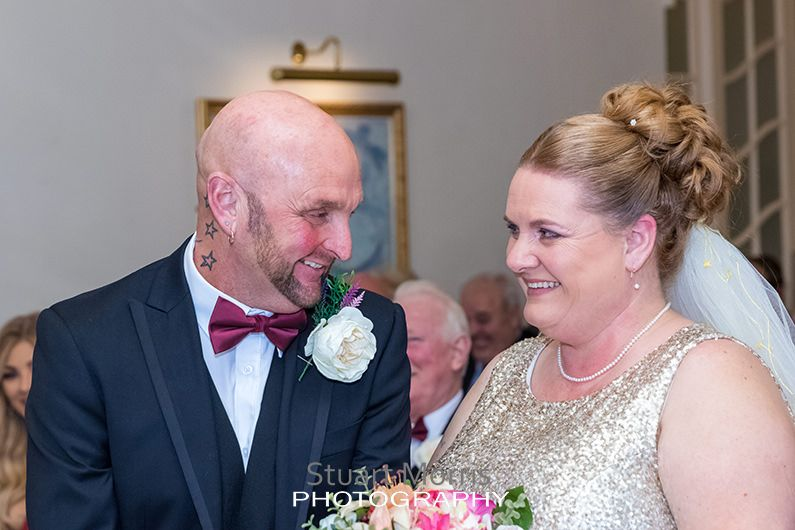 bride and groom laughing during the ceremony at the prince of wales hotel southport