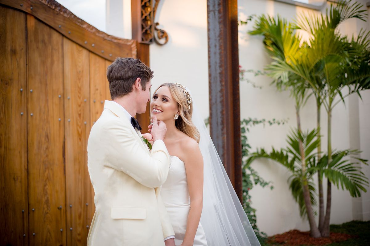 Groom holding Brides chin as she smiles at him. Located at Venue650 Winter Haven Florida Wedding Photographer