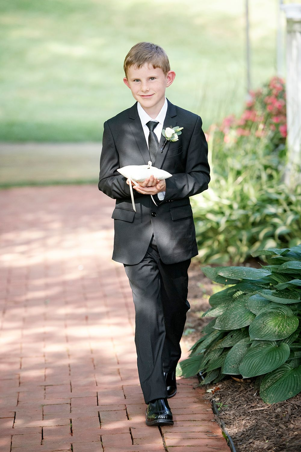 ring bearer walking at backyard micro wedding