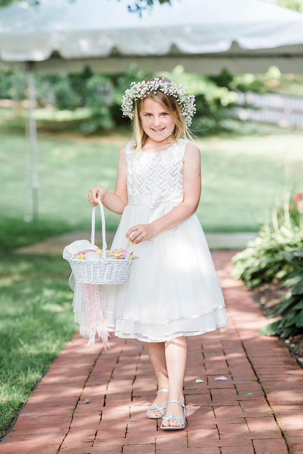 flower girl at backyard micro wedding