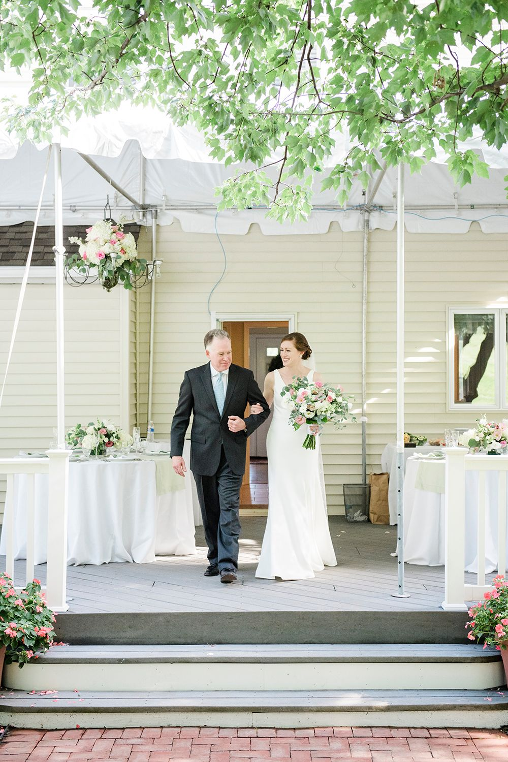 bride's father escorting her at a backyard micro wedding