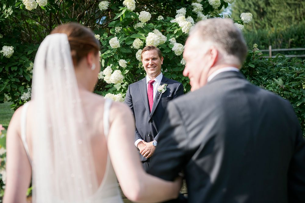 groom's first look at backyard micro wedding