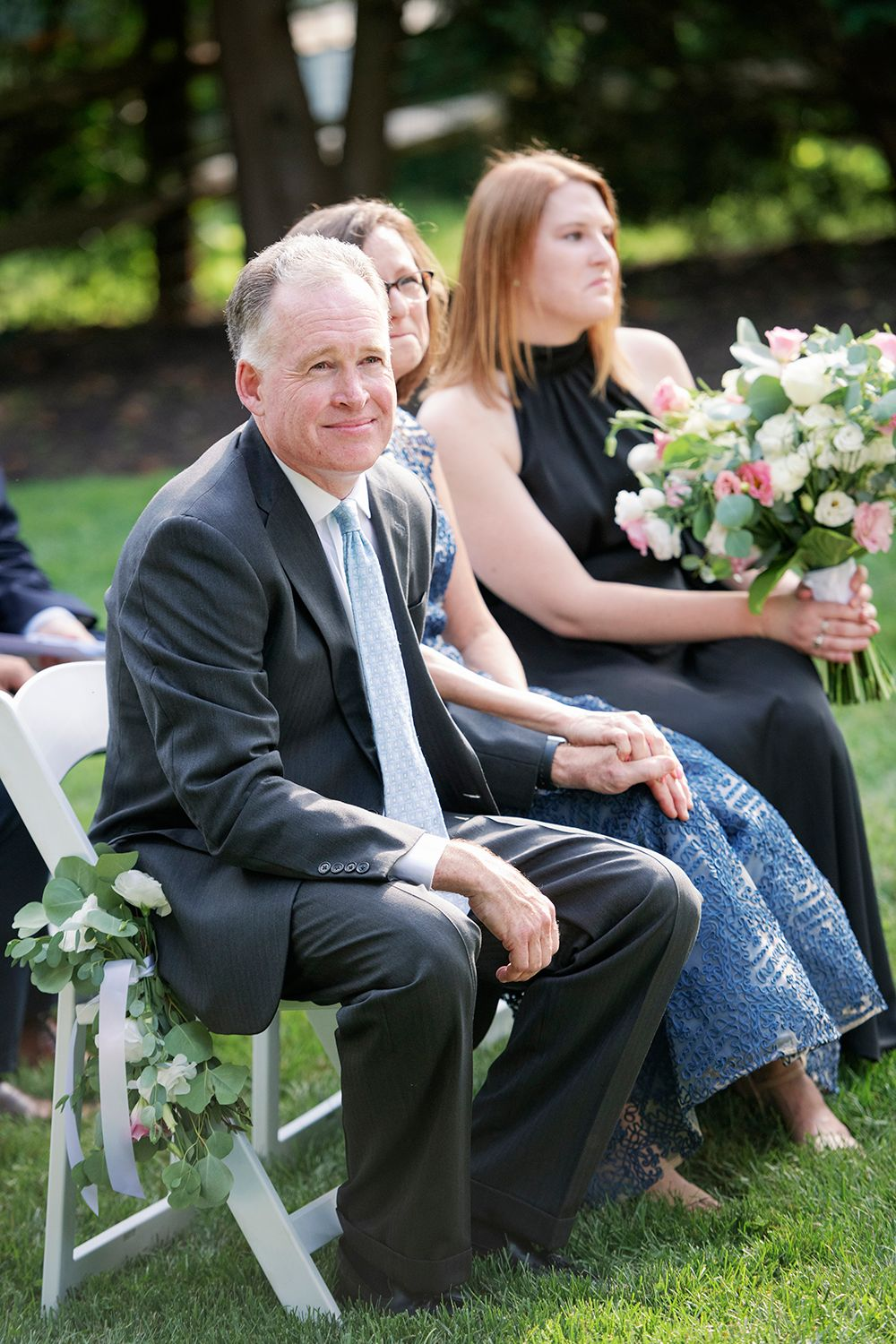 father watches ceremony at backyard micro wedding