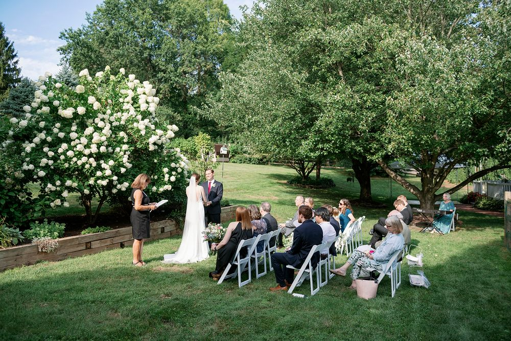ceremony site and guest at backyard micro wedding