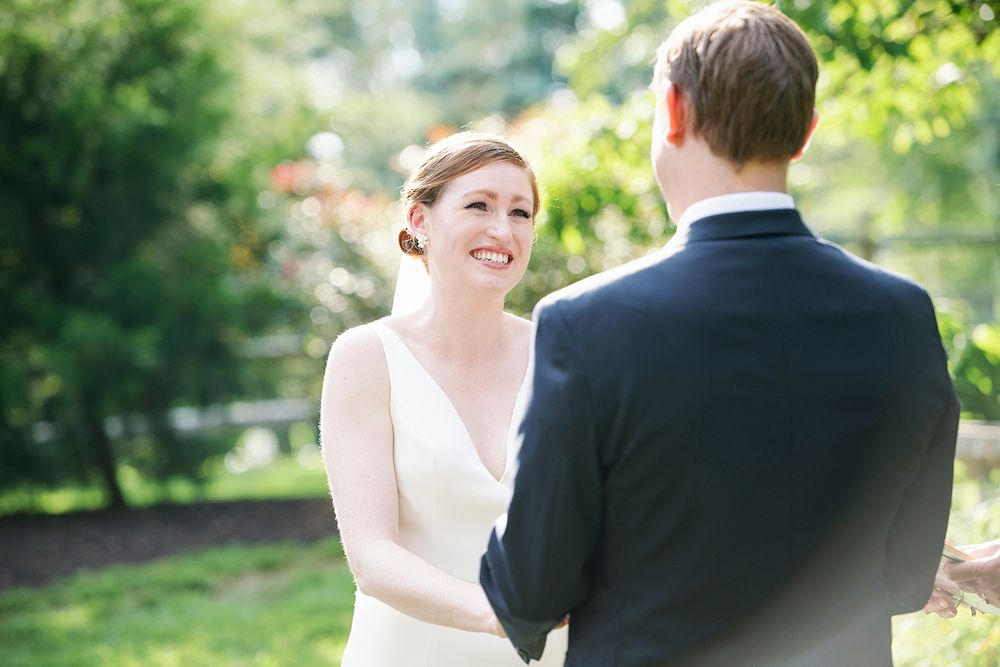 bride says her vows during backyard micro wedding