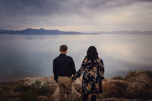 Engagement photos on Antelope Island, a desert landscape with mountains and a salt lake.