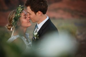 Couple snuggling after exchanging their sunrise vows at Snow Canyon State Park, St. George, Utah.