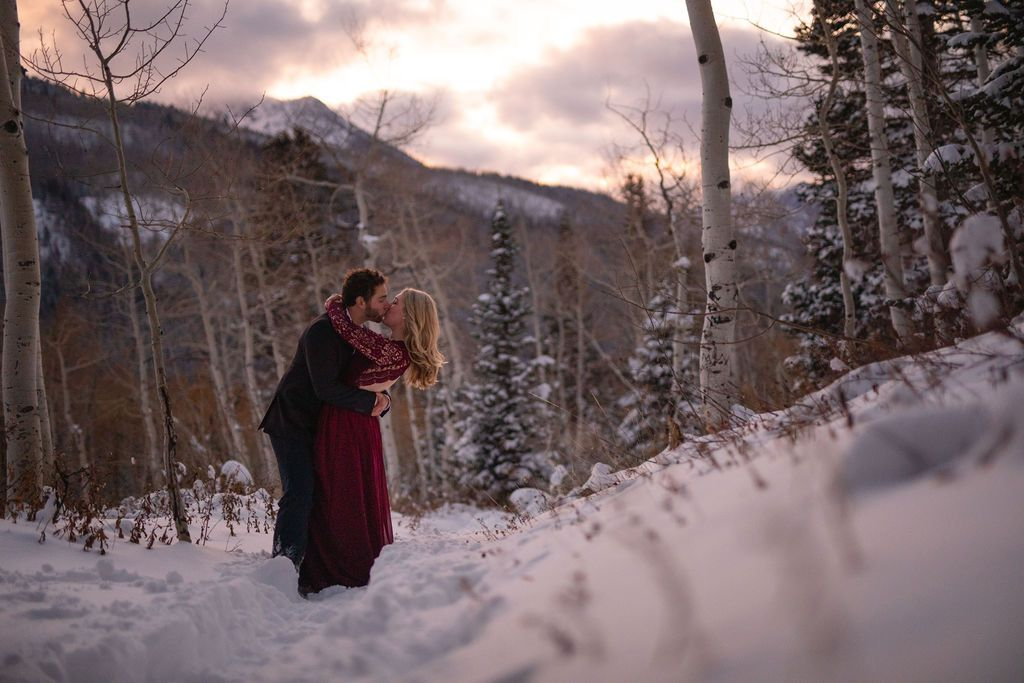 Engagement photos in the snow.  Couple in a snowy aspen forest, Big Cottonwood Canyon, Wasatch mountains, Utah.