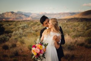 Couple kissing in desert by Zion National Park.