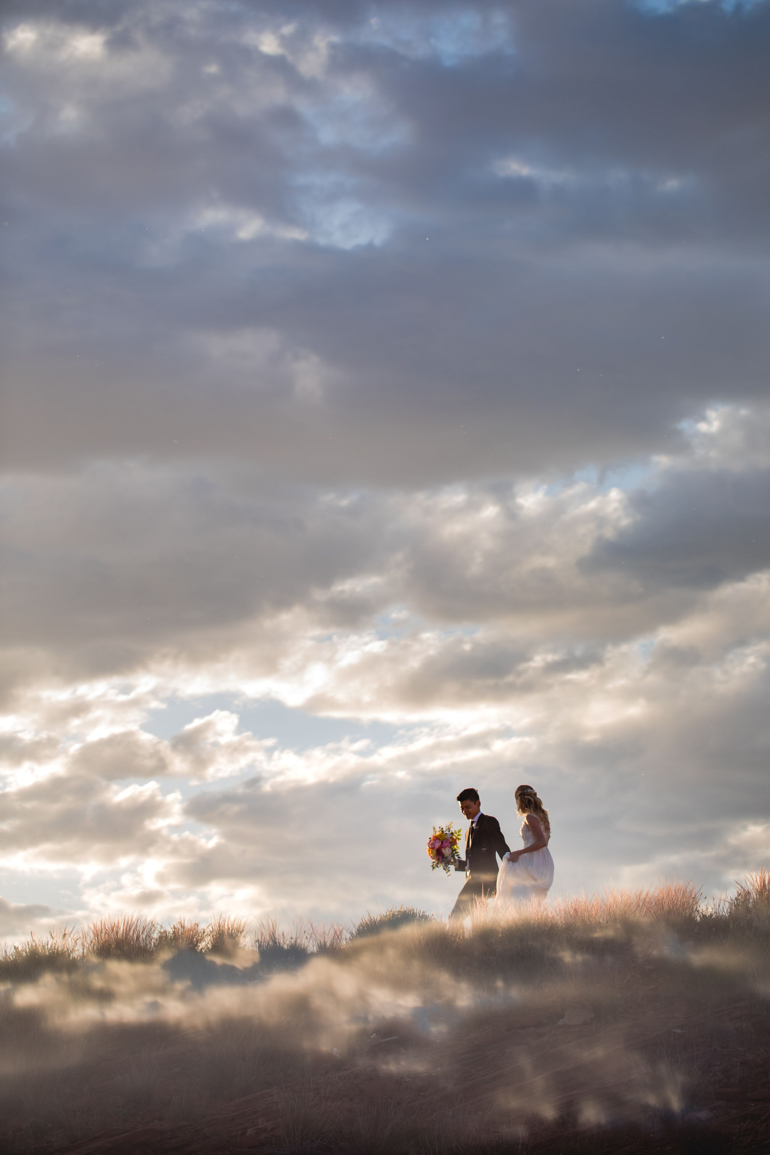 Bride and groom in clouds.  Sand Hollow State Park. Utah. Creative artistic photo.