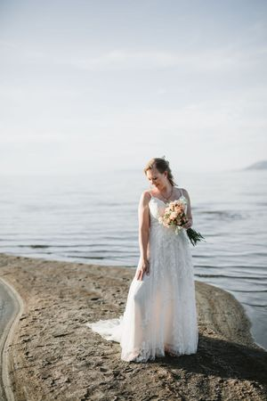Bride at the great salt lake posing for bridals with her bouquet.