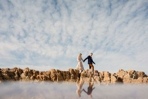 Couple walking on cliff at Antelope Island State park.  Artistic photo.