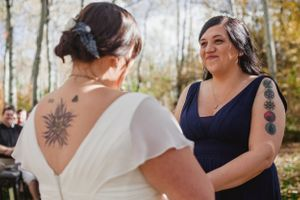 Two brides exchanging vows in an aspen forest.  Park City mountains, Utah. LGBTQ love.