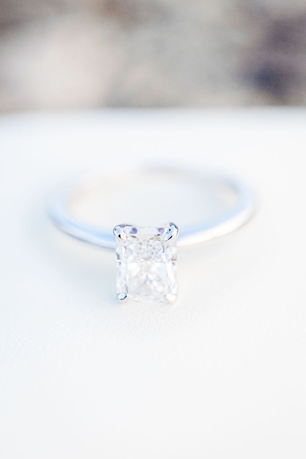 rectangle cut diamond engagement ring on white ring box after Chicago proposal