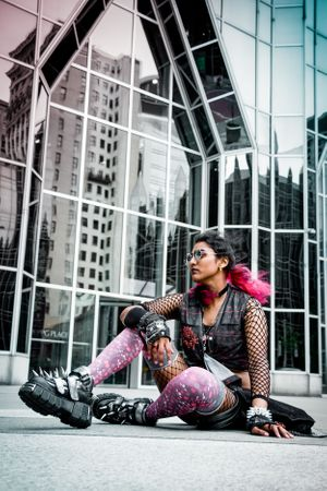 A fashionable model wearing alternative fashion clothing from the brand Puvithel poses at PPG Place downtown Pittsburgh
