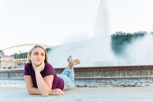Graduating high school senior poses near the fountain at the point in Pittsburgh PA for senior photos
