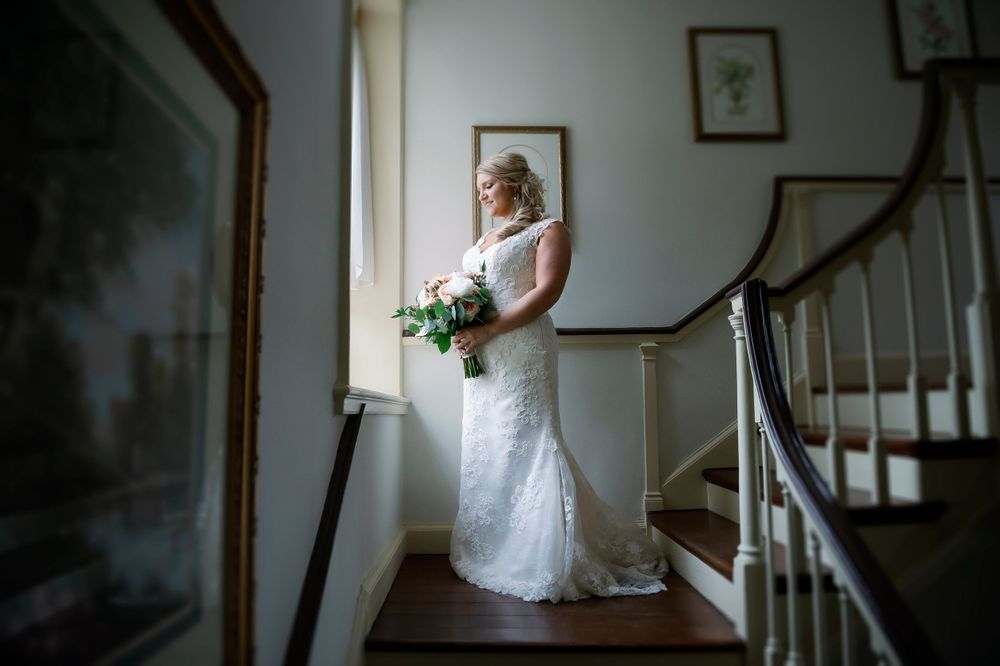 wedding photo of bride in window light staircase