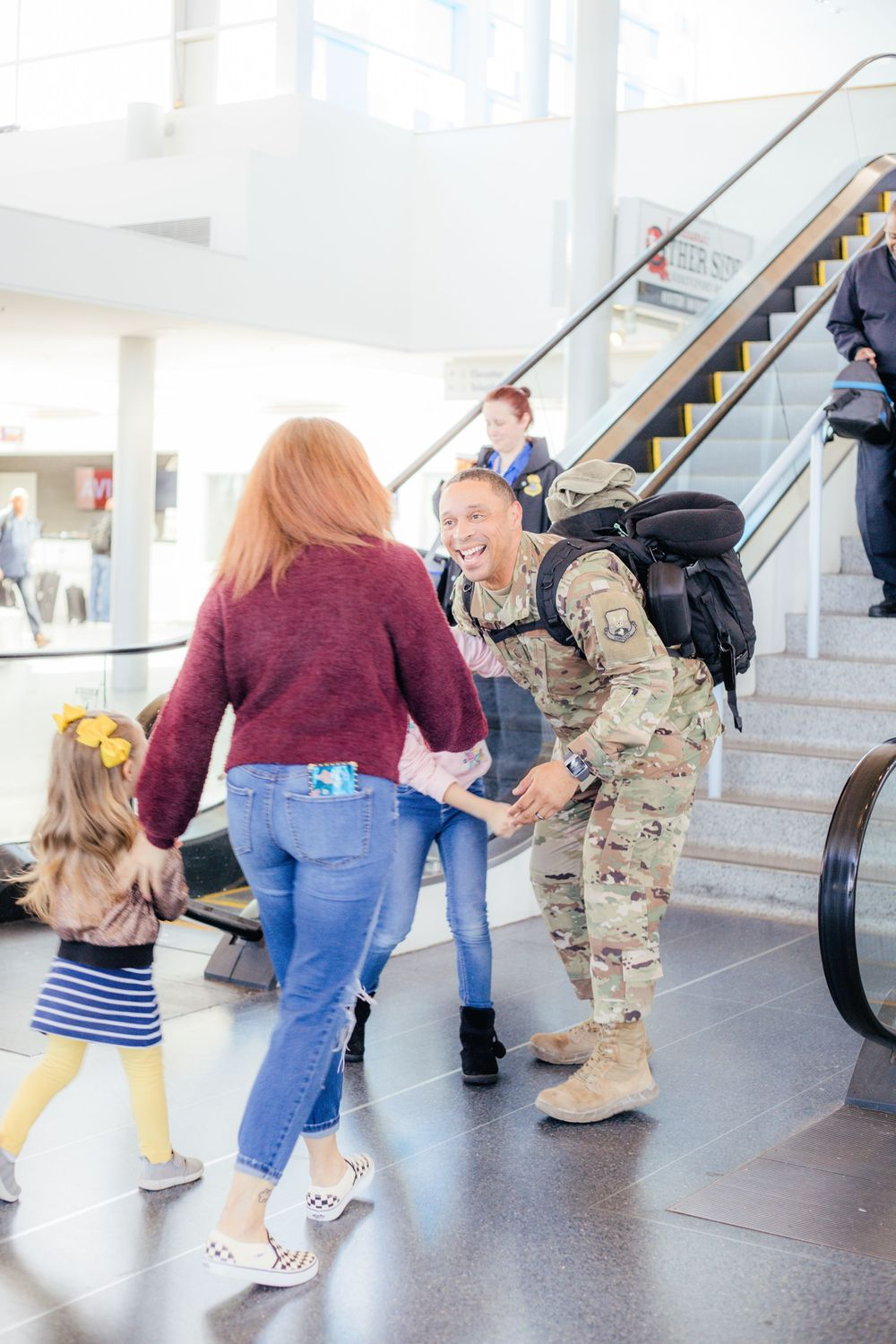Airport military family homecoming deployment camo