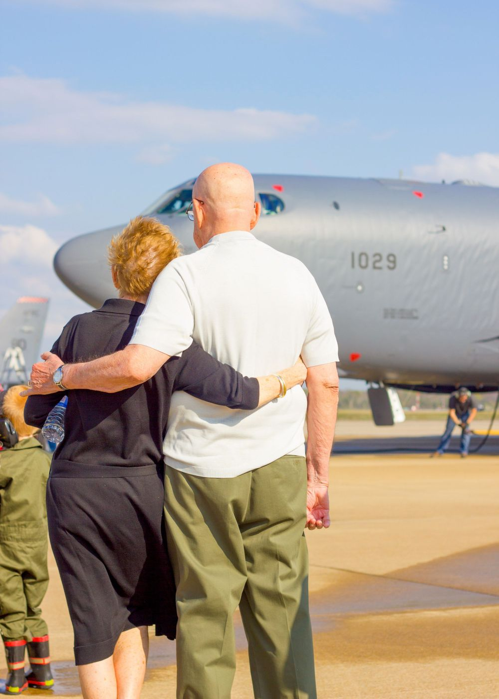 B52 military retirement couple looking with pride at son's retirement BUFF flight line