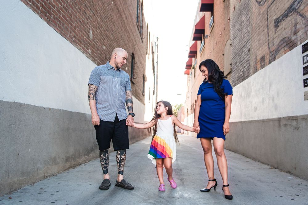 Photo of a family standing in an alley in Orange, CA
