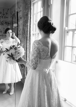 Bride looking in mirror wedding photography