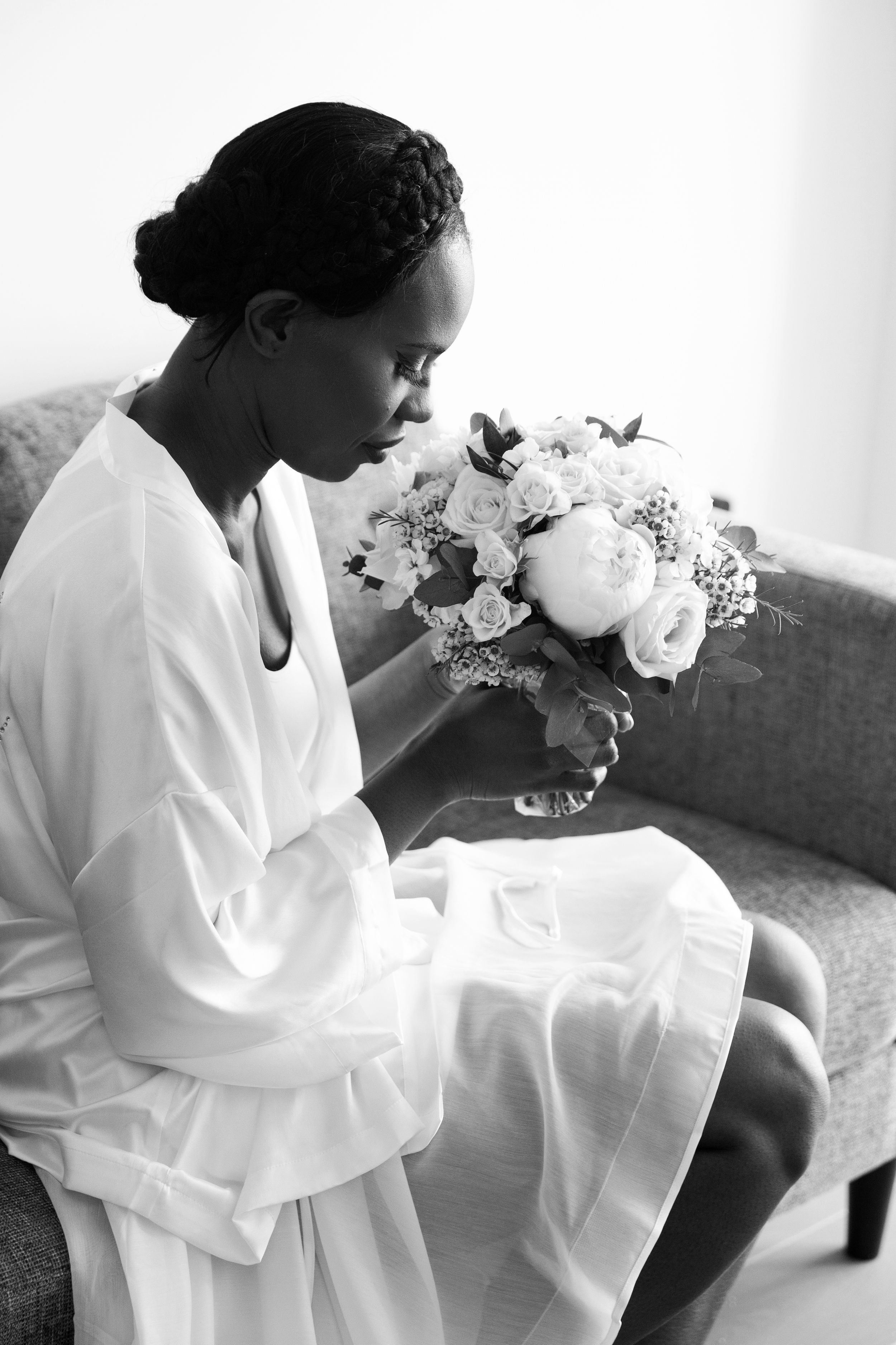 Black bride getting ready with bouquet wedding photography