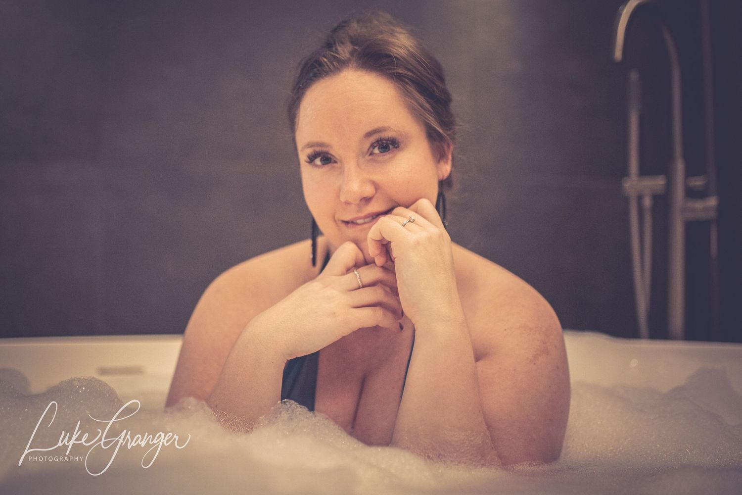 boudoir photo close up of woman in a bubble bath
