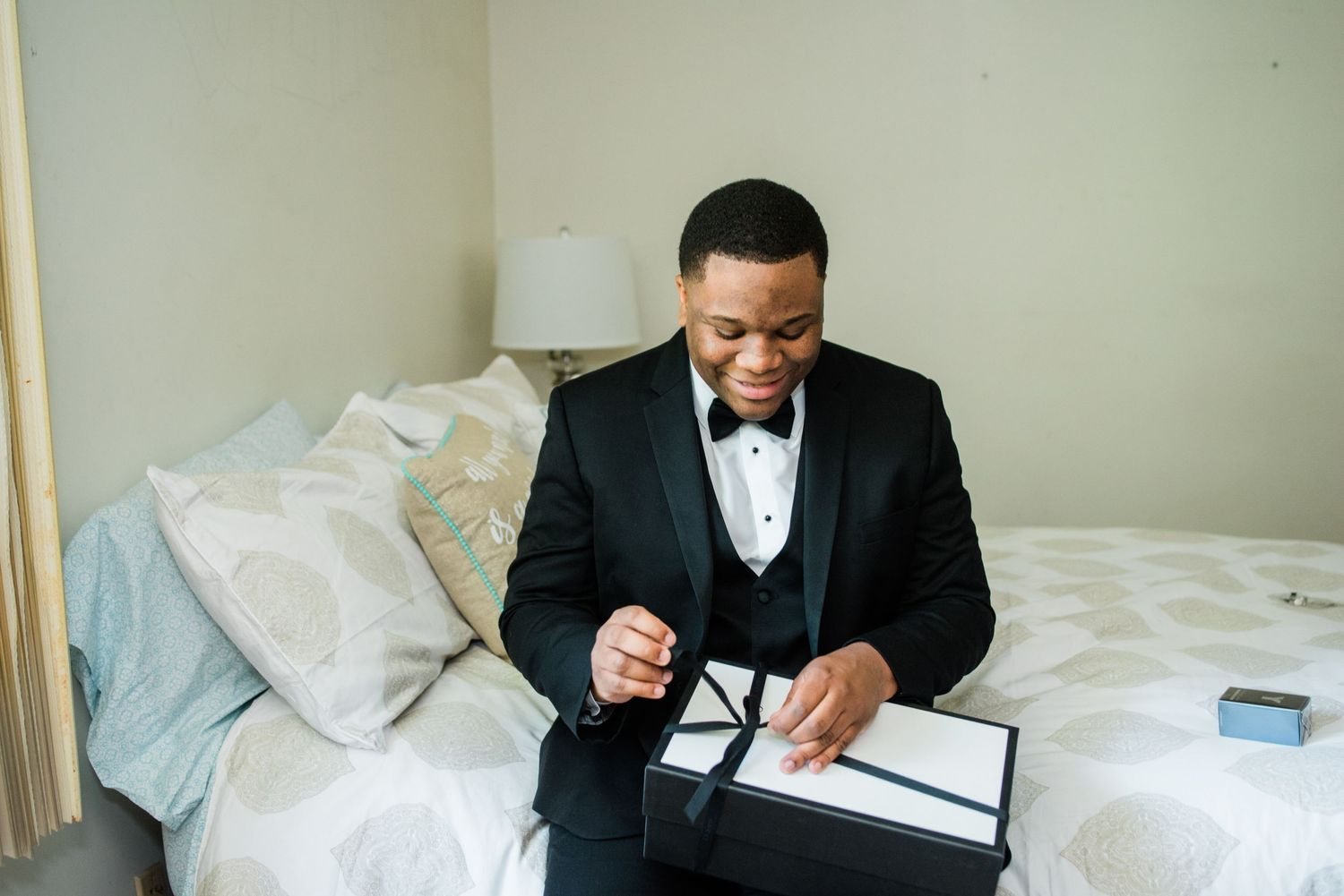 groom opening wedding gift box