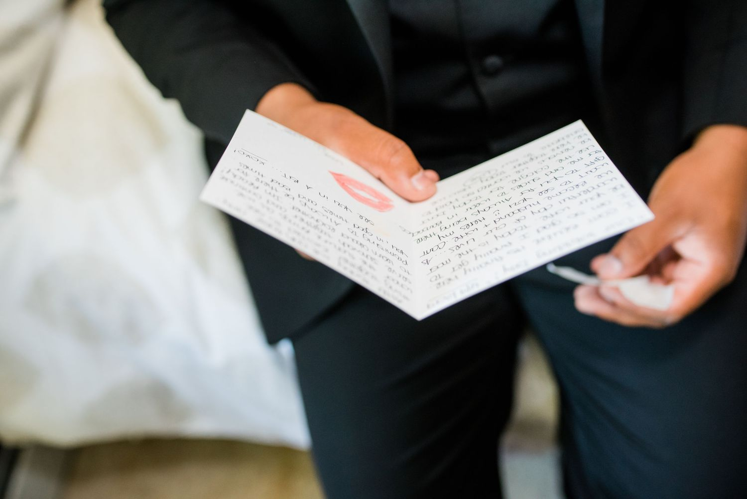 groom holding card in hand